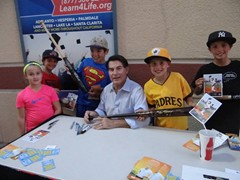 Baseball Great, Steve Garvey signing autographs for fans at a Lancaster Jethawks game.