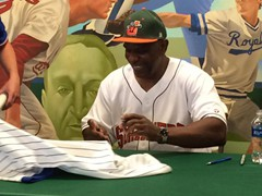 Cubs Legend, Andre Dawson signing autographs for fans at a Joliet Slammers game.